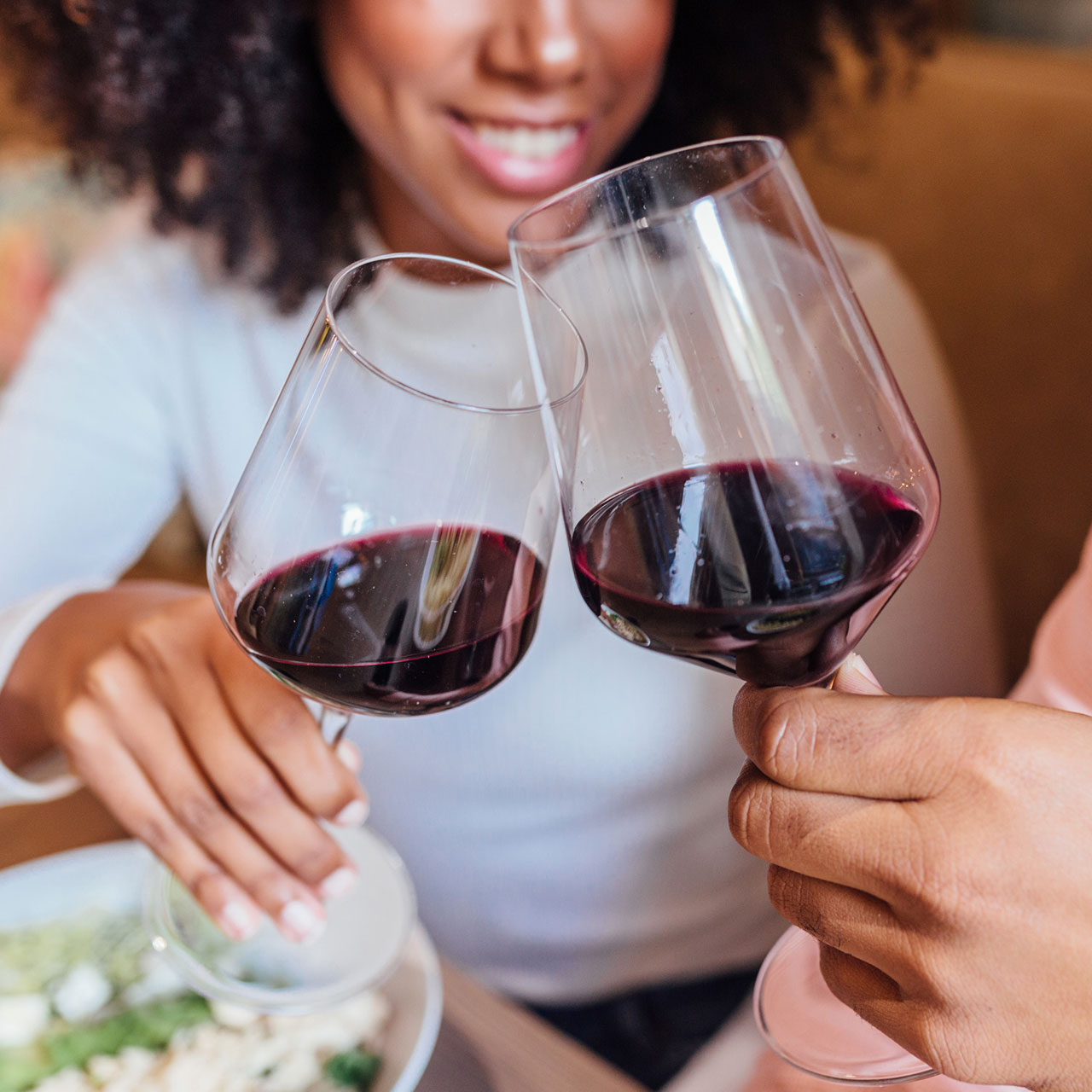 Socialize Luxuriously Two People with Wine in Glasses